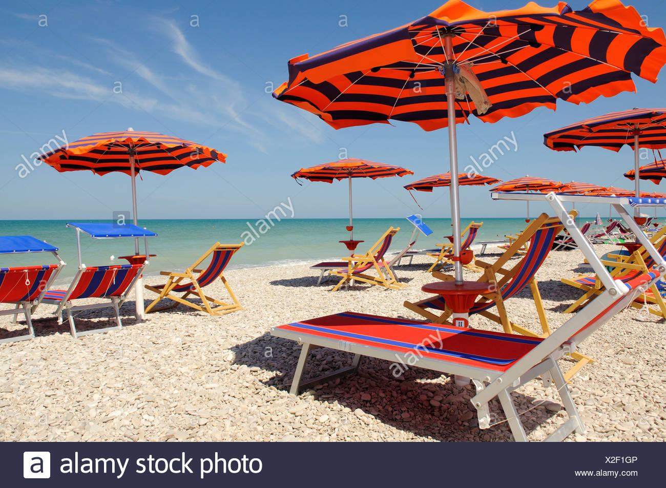 Sun umbrellas and deckchairs on the beach of Pineto, Abruzzi, Europe Stock Photo