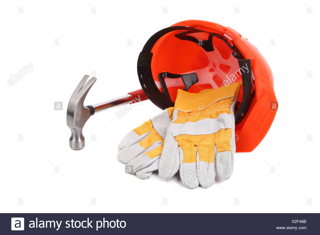 Hard head gloves and hammer. Stock Photo