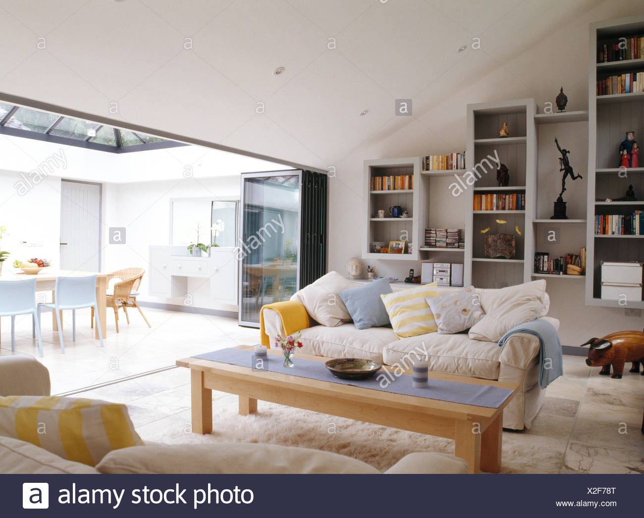 White Sofas And Pale Wood Coffee Table In Modern Living And