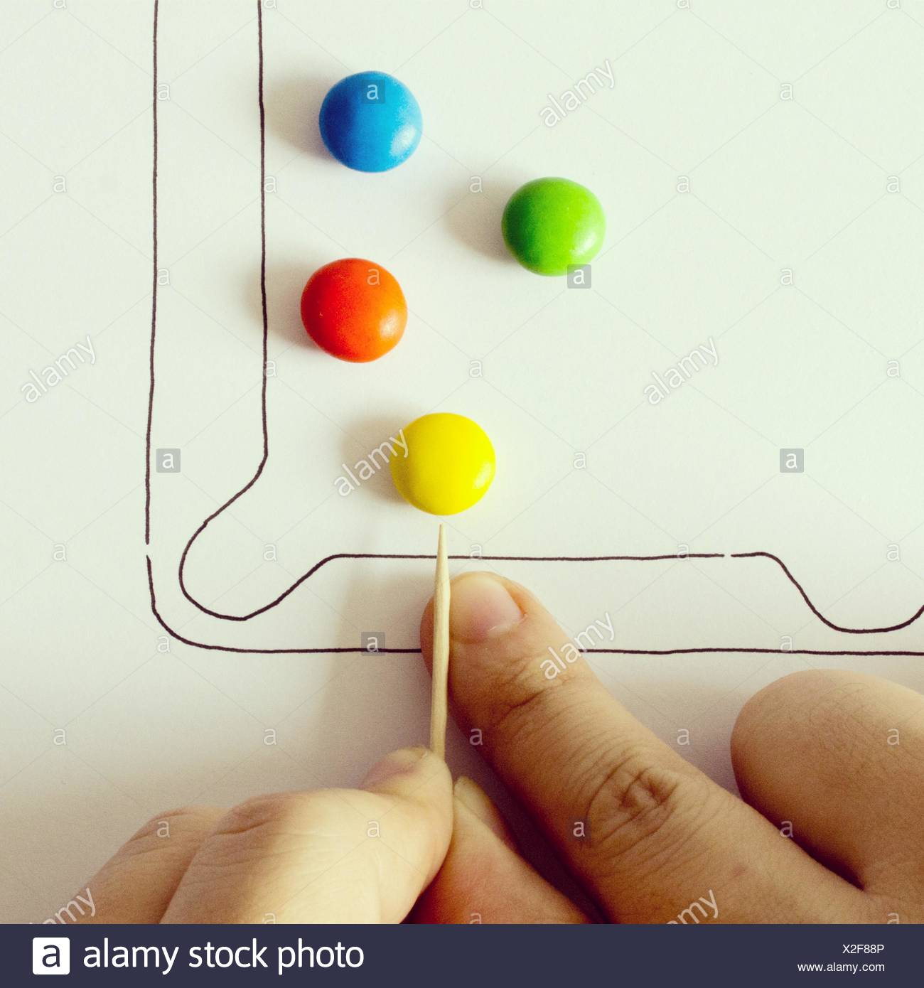 Illustration of pool game with colorful candies - Stock Image