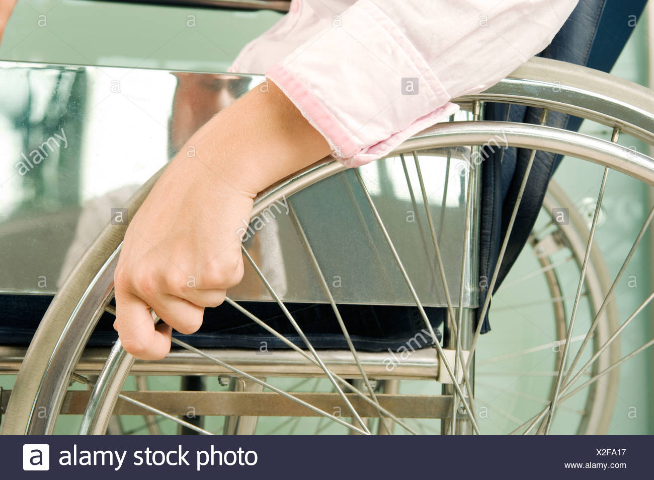 A woman sitting in a wheelchair - Stock Image