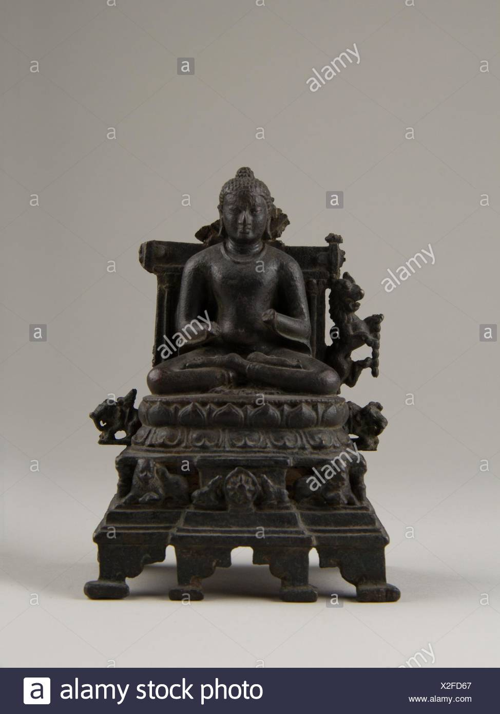 Enthroned Preaching Buddha. Period: Pala period; Date: late 9th century; Culture: India (Bihar); Medium: Bronze with silver inlay; Dimensions: H. 5 - Stock Image