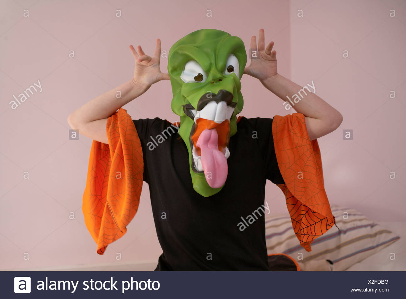 Child grimacing in Halloween costume - Stock Image