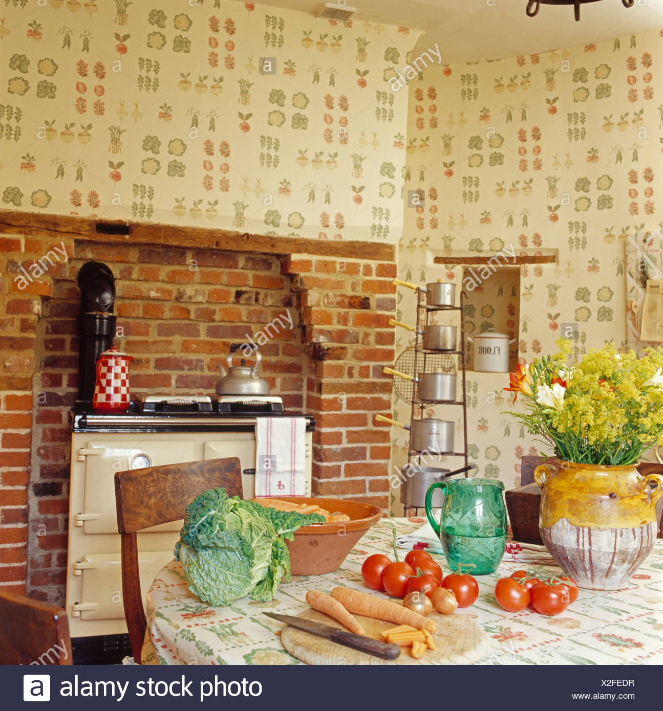 Vegetables on table in country kitchen with cream Aga oven and