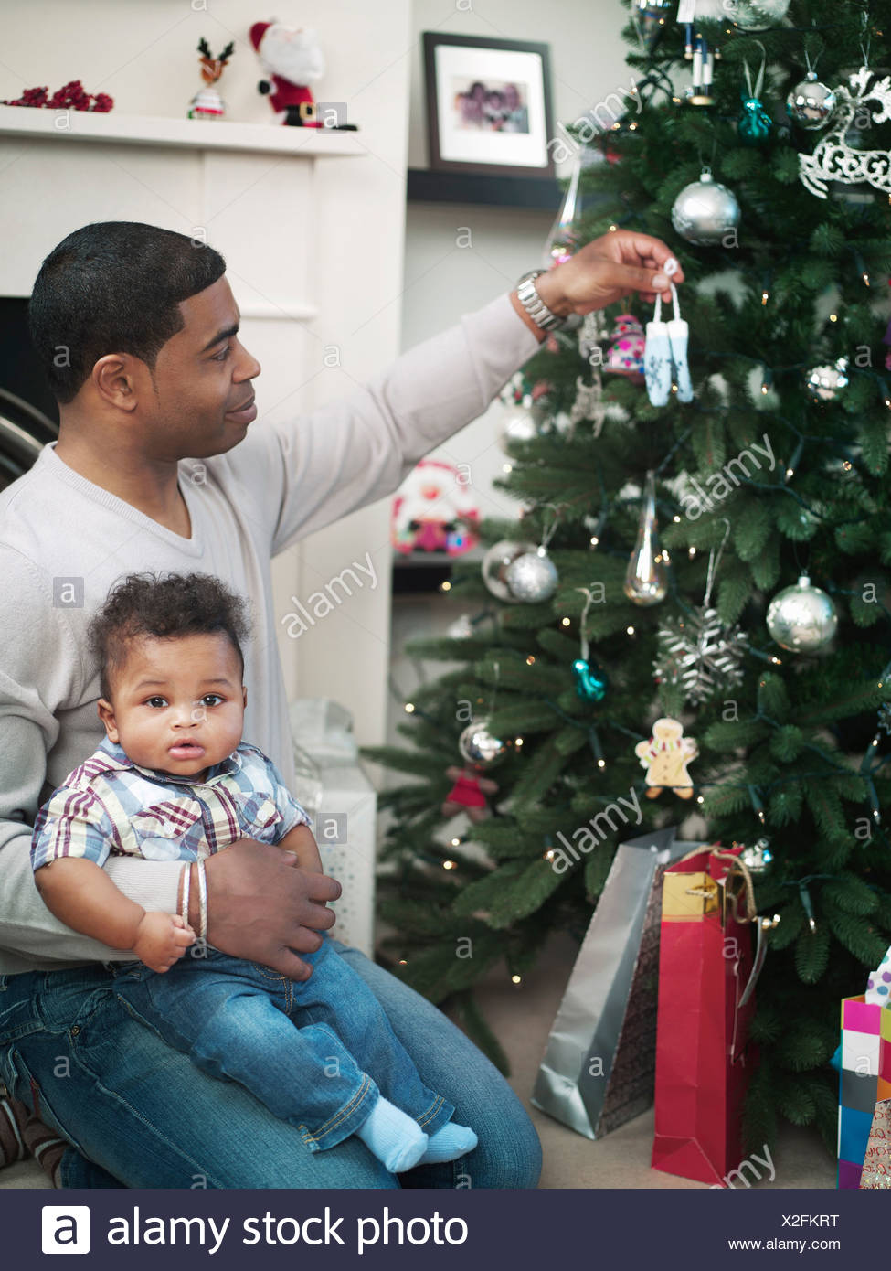 Father And Baby Boy Decorating Christmas Tree Stock Photo Alamy