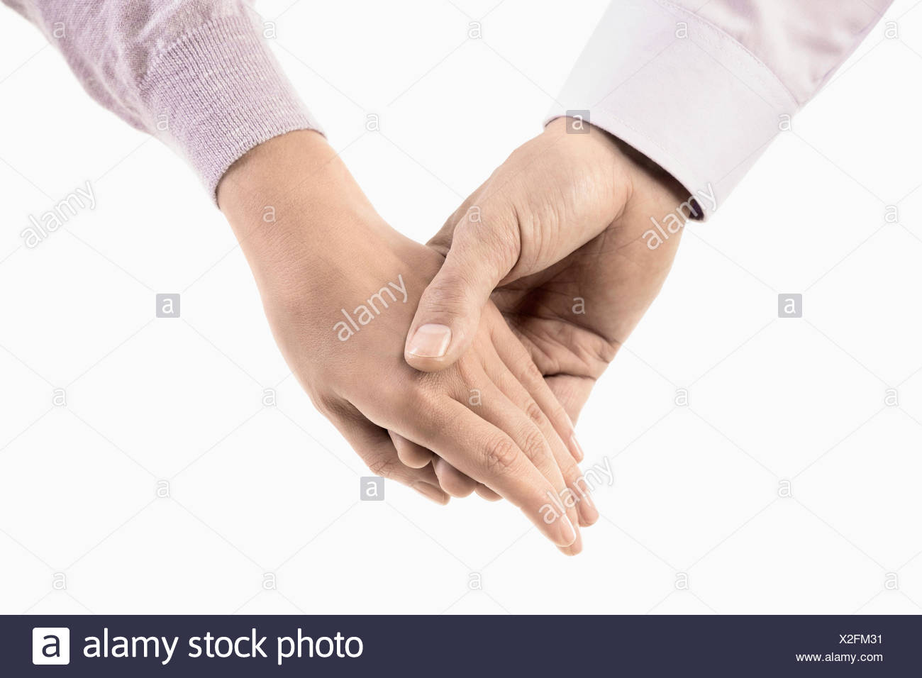 Close-up of man holding hand of woman, Bavaria, Germany - Stock Image