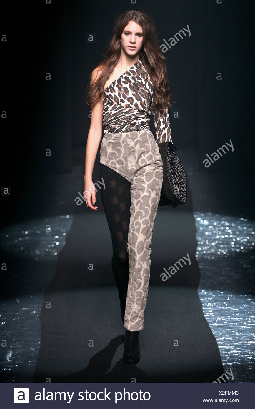 632cd5e5cdeb Martin Margiela Paris Ready to Wear Autumn Winter Model wearing brown one  leg trousers over black