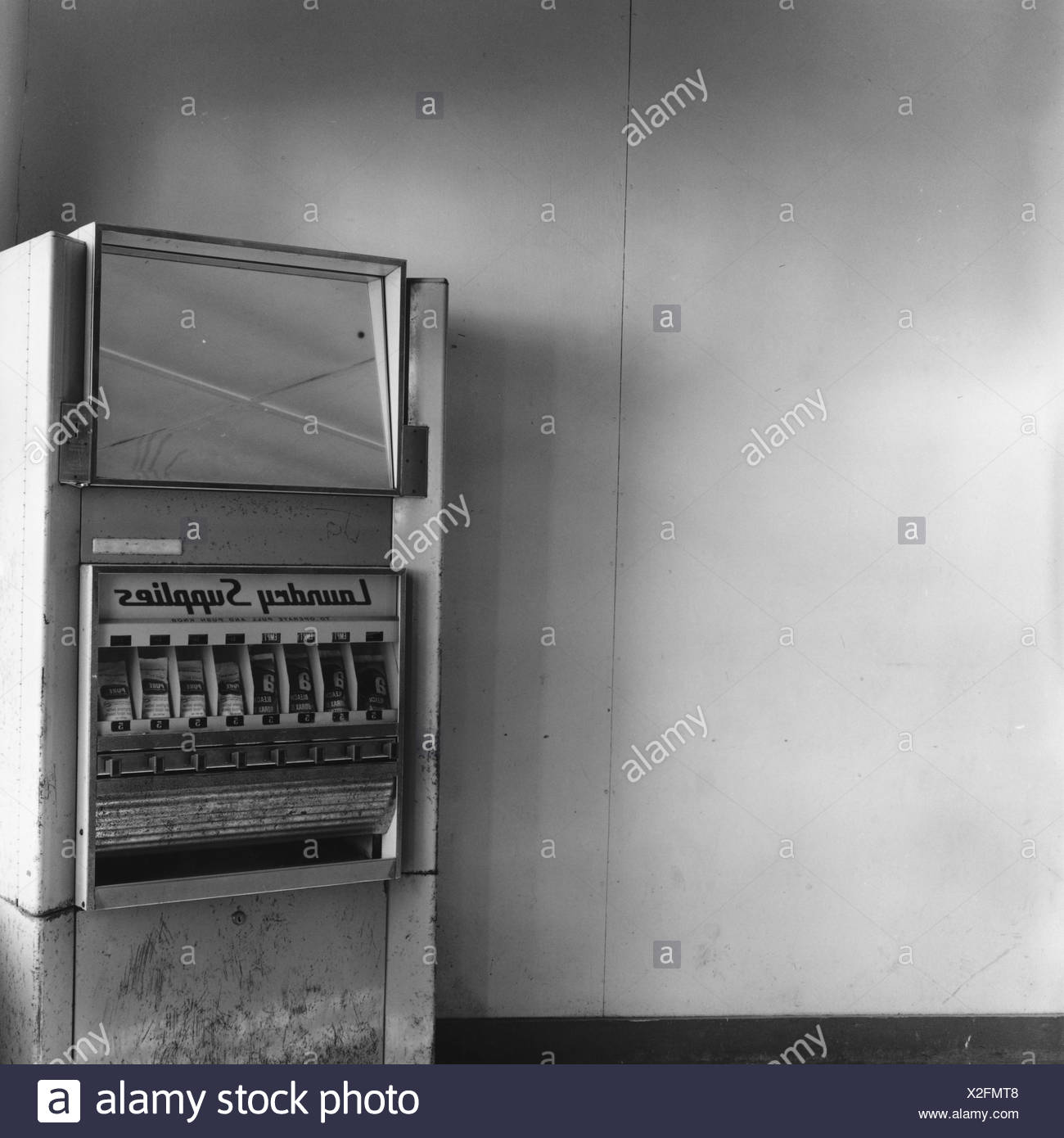 Old laundry supplies dispenser - Stock Image