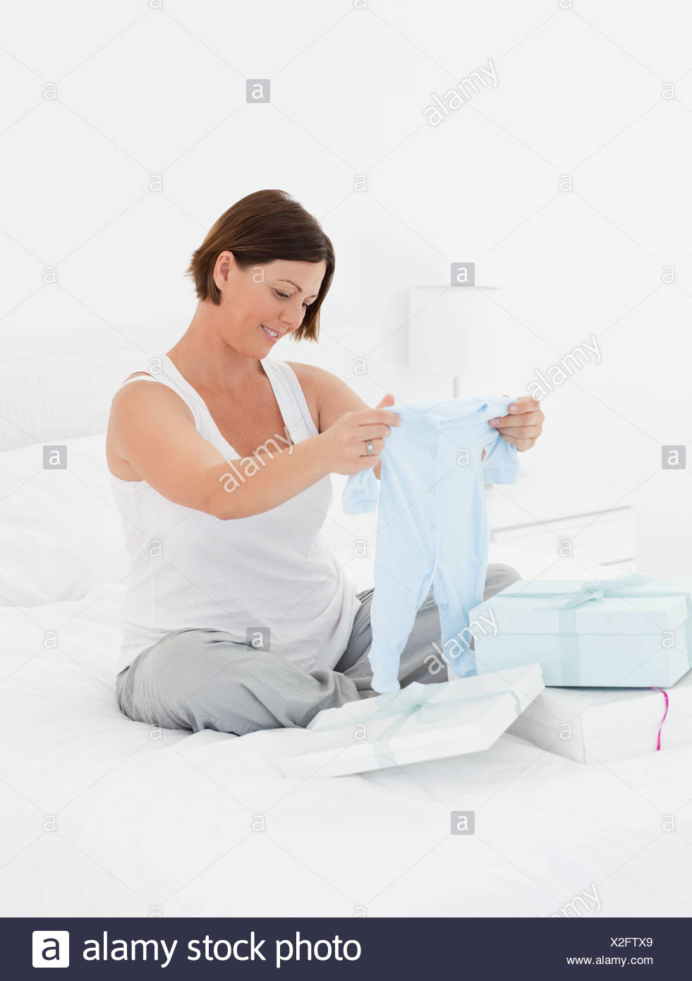 Woman with childrens clothes - Stock Image