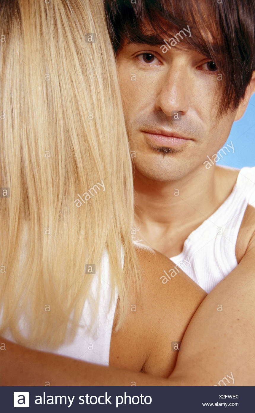 Woman, back view, detail, man, seriously, embrace, portrait, curled, couple, young, affection, touch, suture, closely packed, back the head, dark-haired, short-haired, blond, long-haired, expression, is relaxing, sadly, tearful - Stock Image