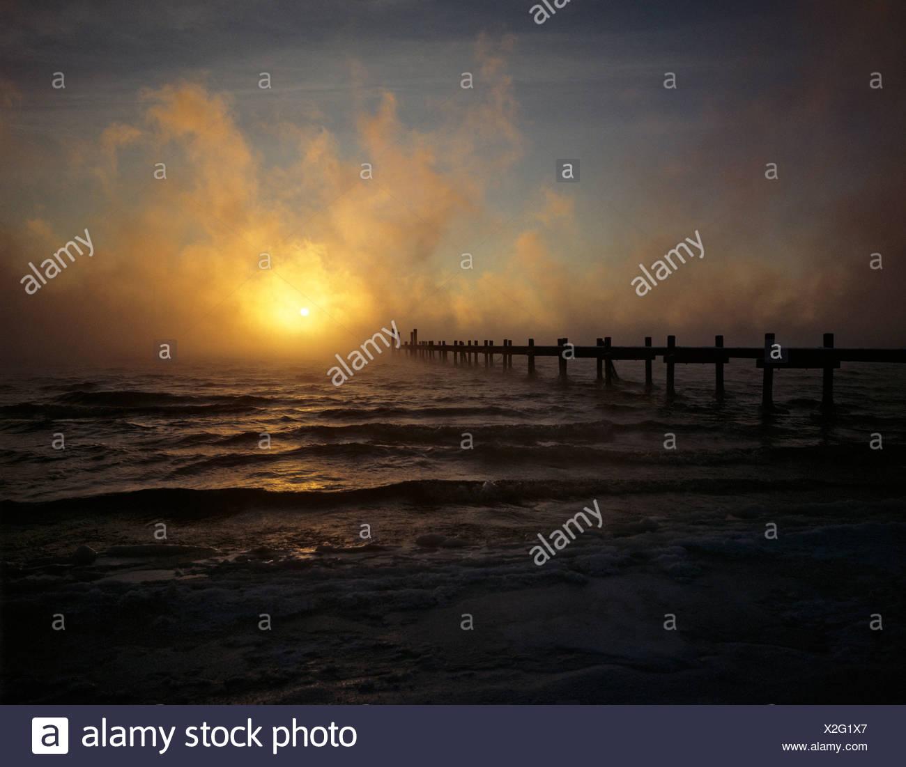 Sunset, waft of mist, Lake Chiemsee, Bavaria, Germany - Stock Image