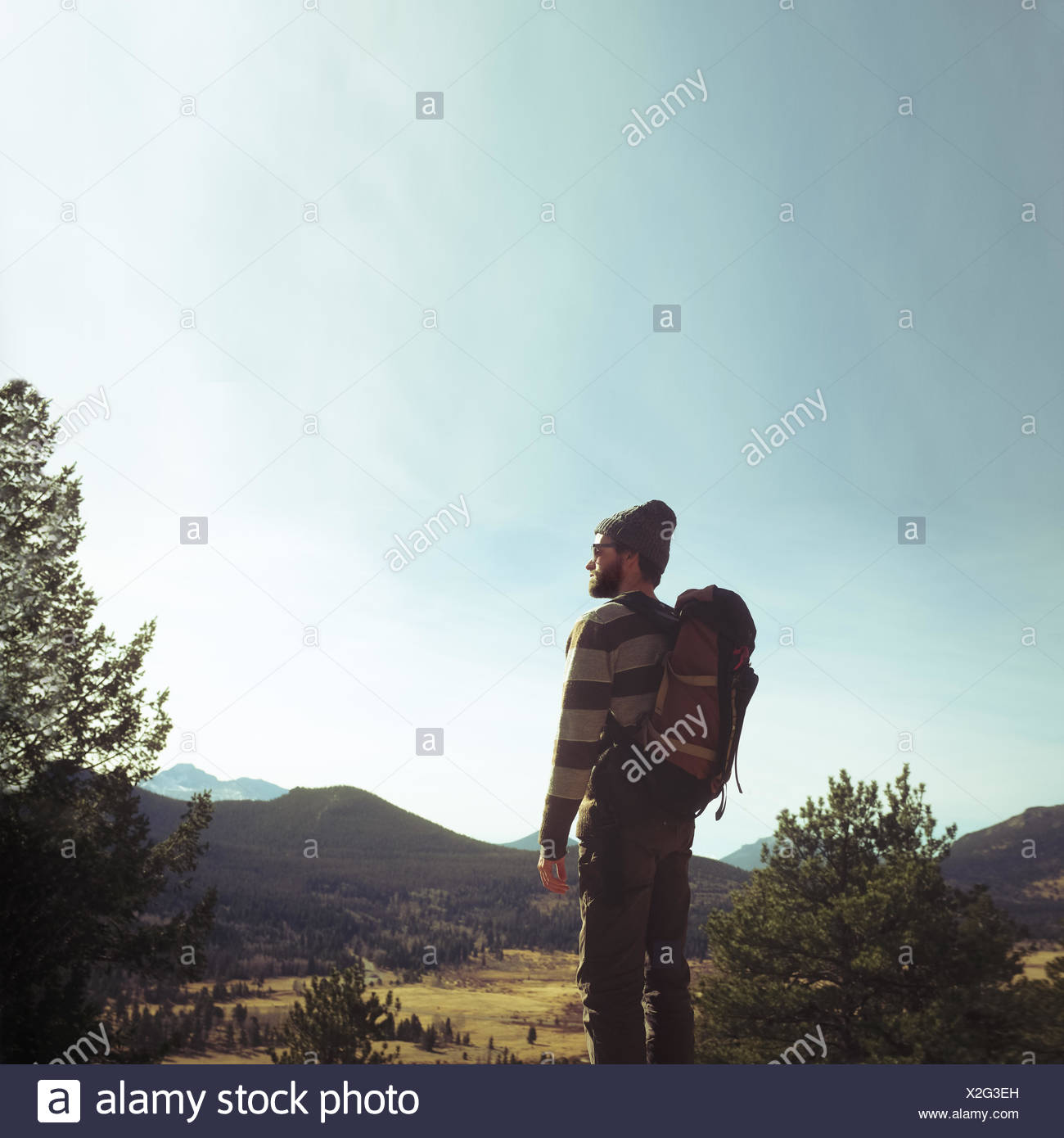 Hiker looking at view - Stock Image