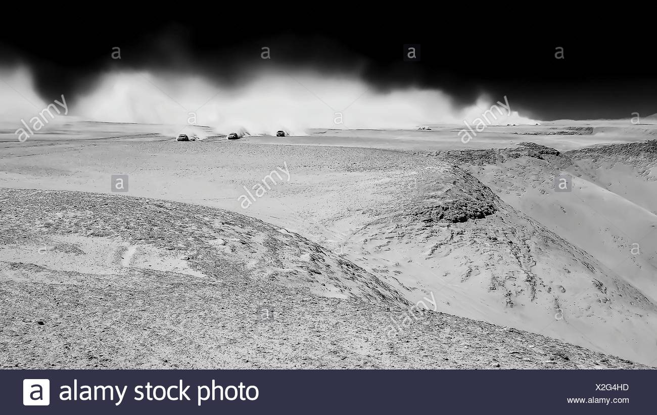 Distant View Of Cars Moving On Desert - Stock Image
