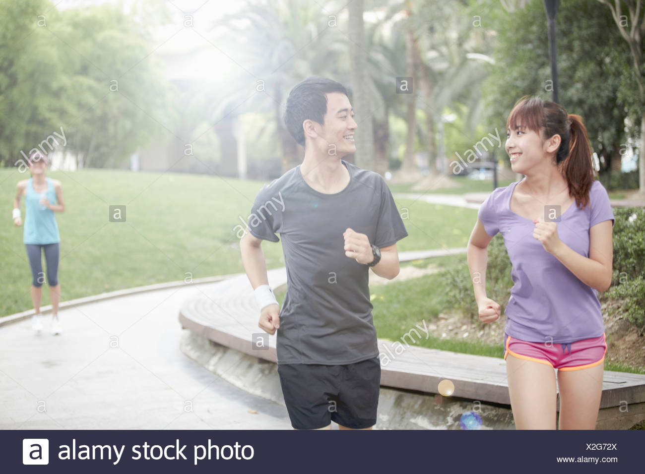 Young people running in park Stock Photo