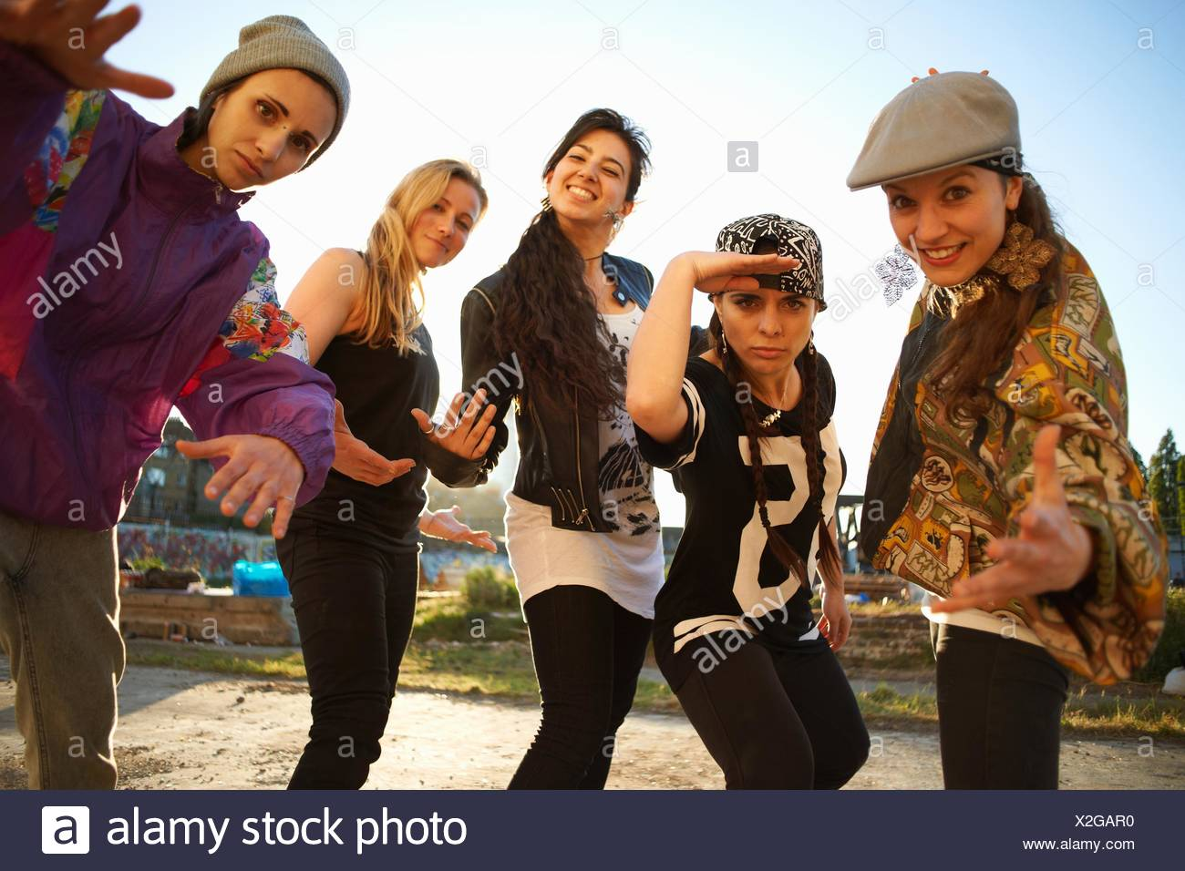 Young women standing gesturing to camera - Stock Image