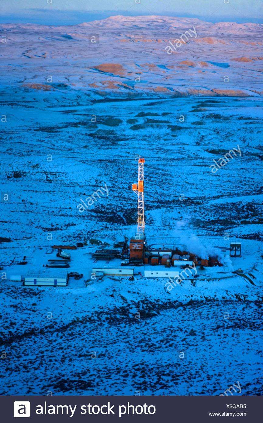 Onshore Oil Drilling Rig in Remote Snow Covered Terrain - Stock Image