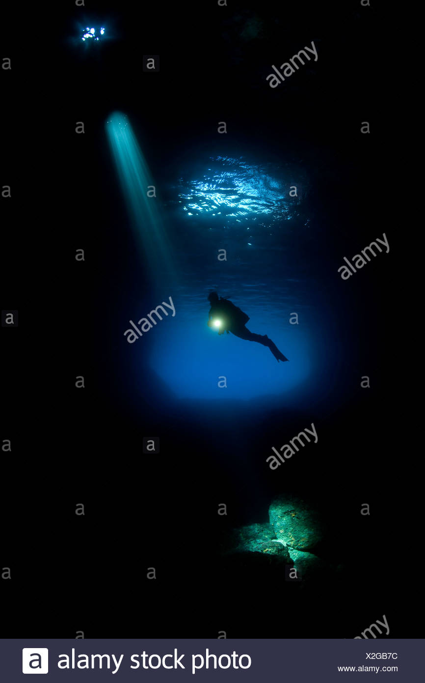 Scuba Diver Silhouette in Green Cave, Vis Island, Adriatic Sea, Croatia - Stock Image