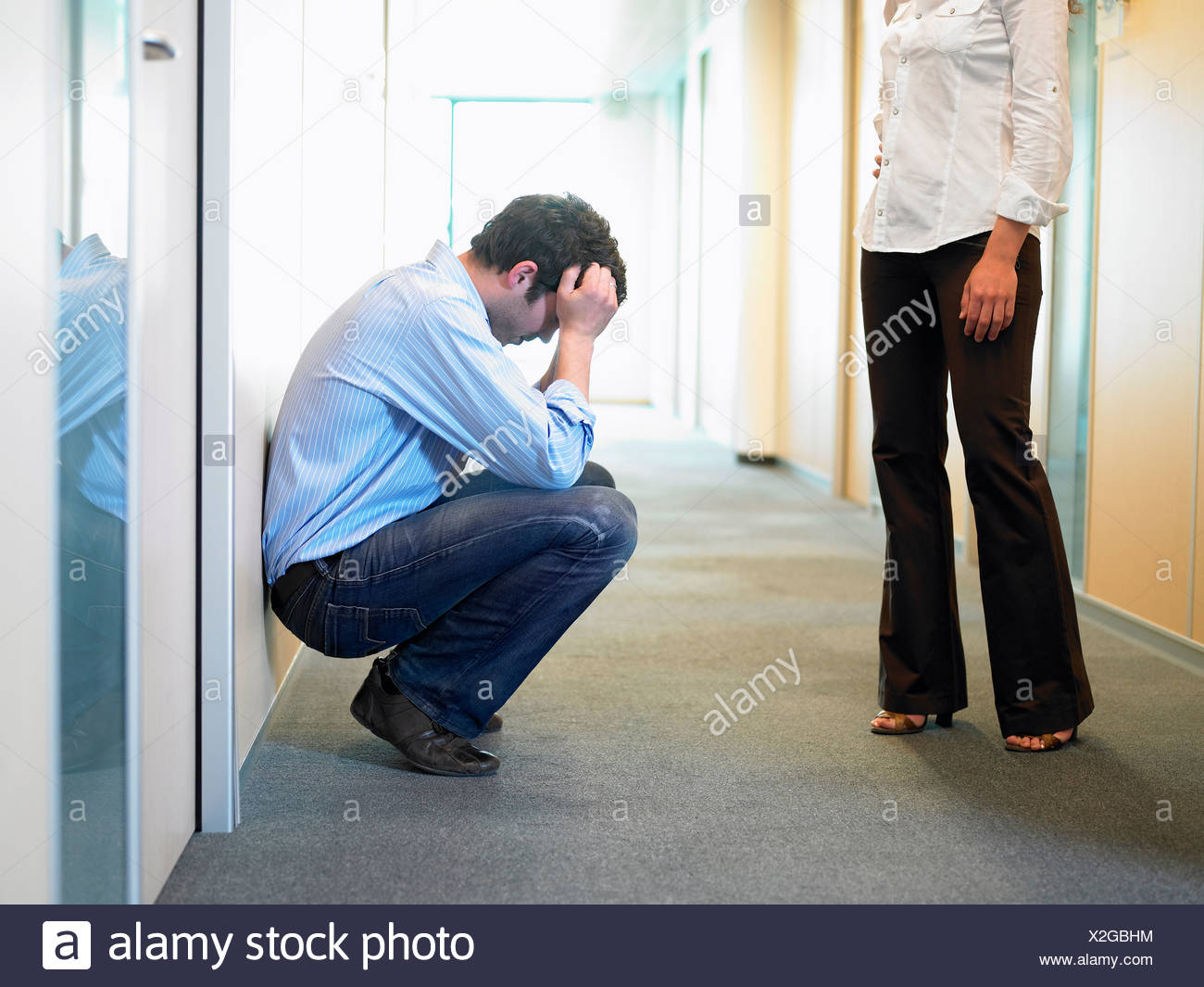 Couple having problems at work - Stock Image