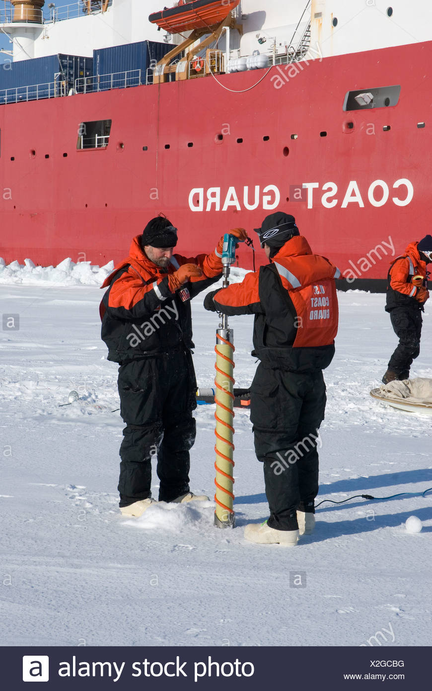 Alaska, Bering Sea. Scientists studying ice condiitons and the changing ecosystem due to global warming. Drilling into the ice - Stock Image
