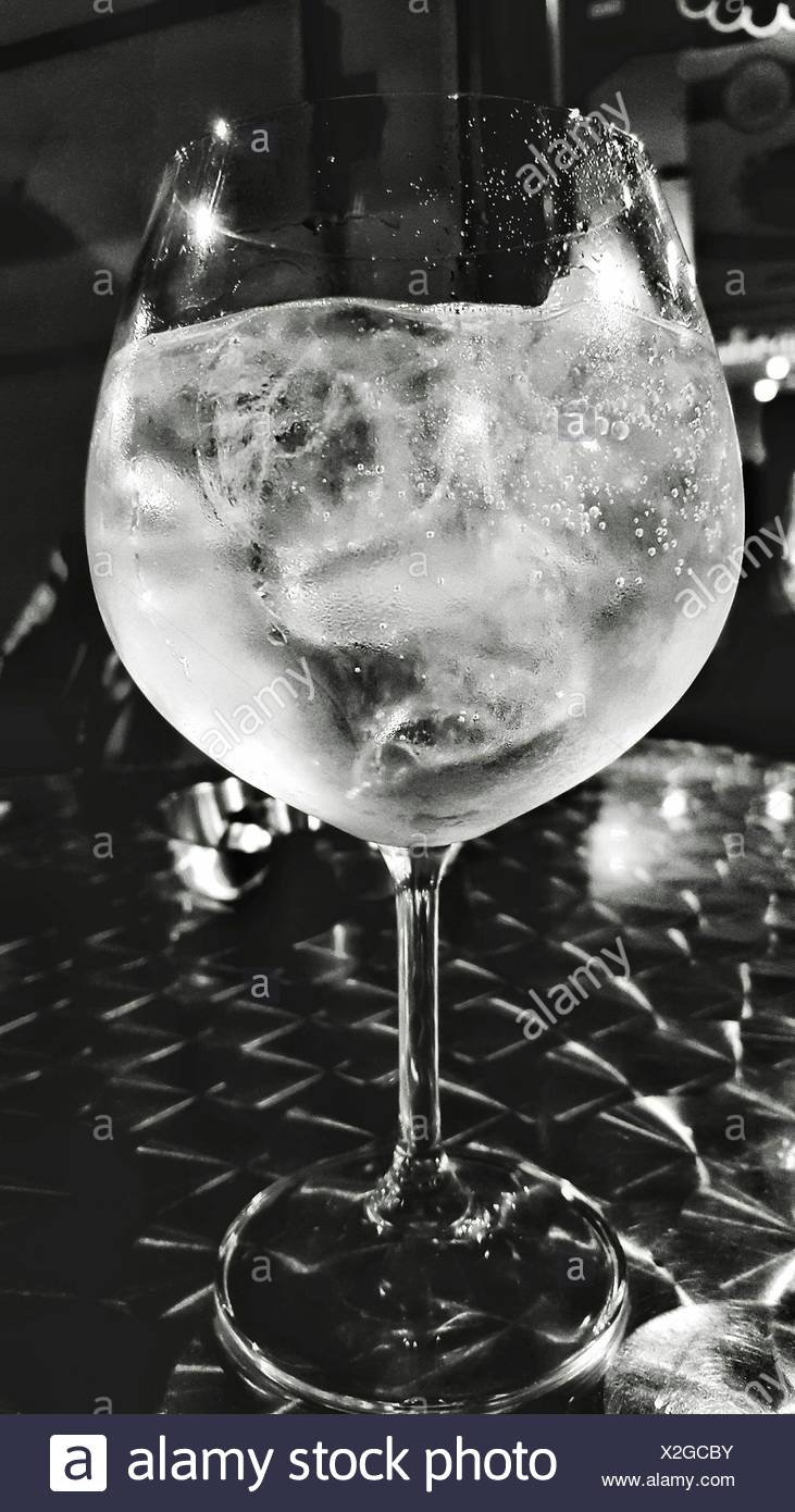 Close-Up Of Gin And Tonic Glass On Table - Stock Image