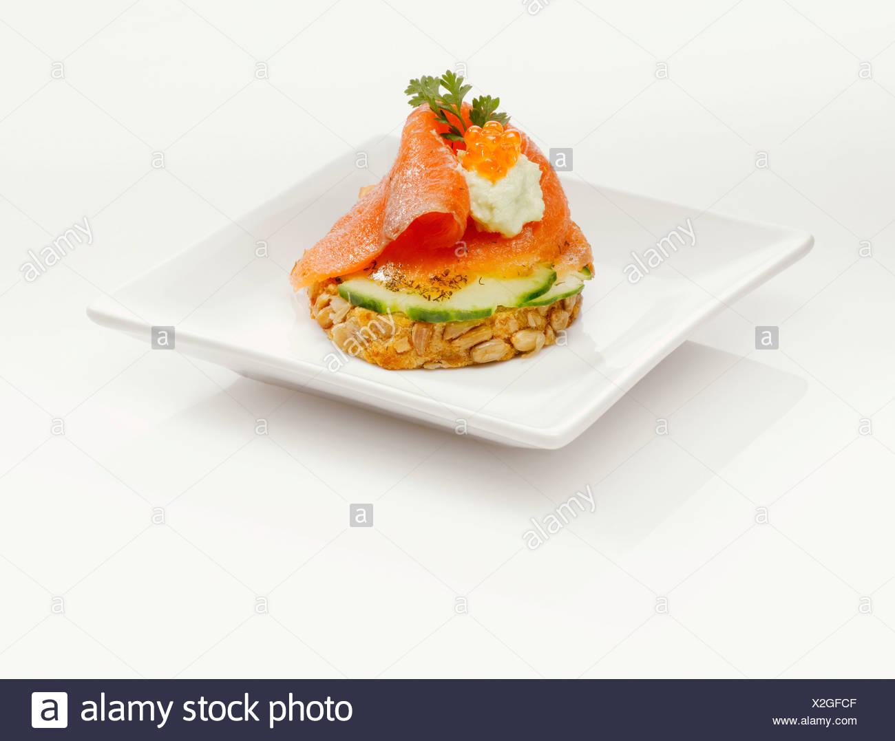 Sandwich with salmon and cucumber slices - Stock Image