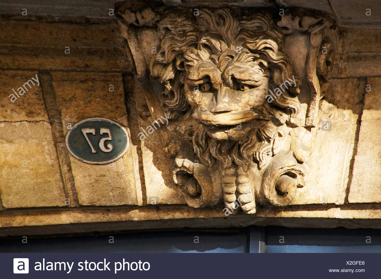 Typical ´mascaron´ (mask) of Bordeaux on the door of 57 Cours d´Albret, at Bordeaux, Gironde, Aquitaine, France - Stock Image