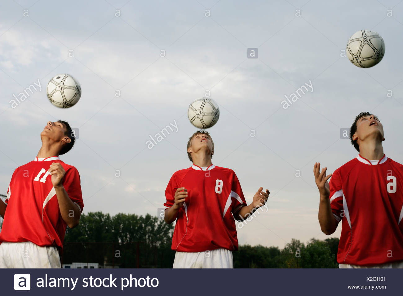 Soccer players doing header exercises - Stock Image