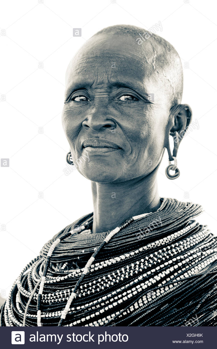 A Samburu woman wears her traditional garments. - Stock Image