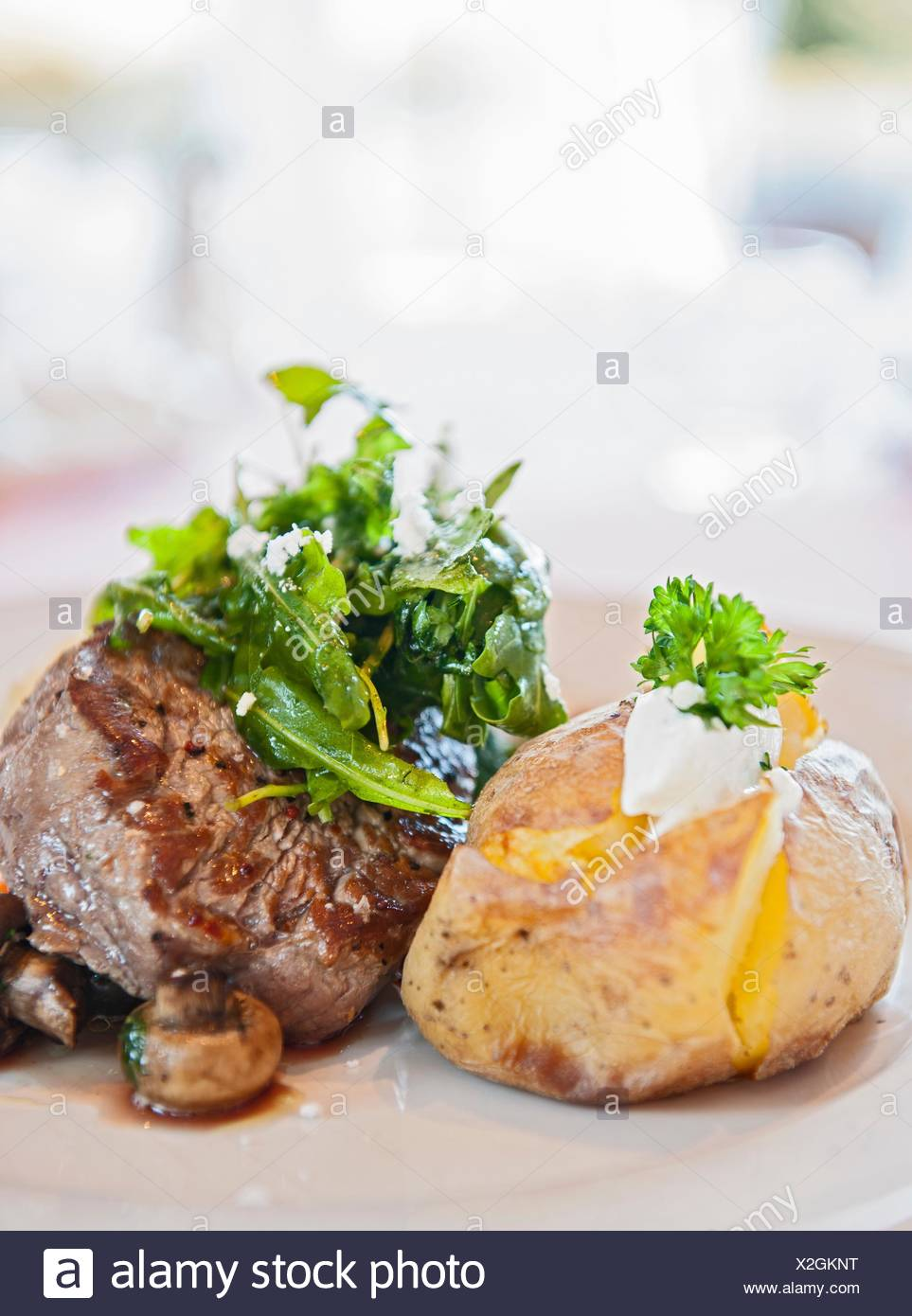 Beef fillet with baked potato - Stock Image