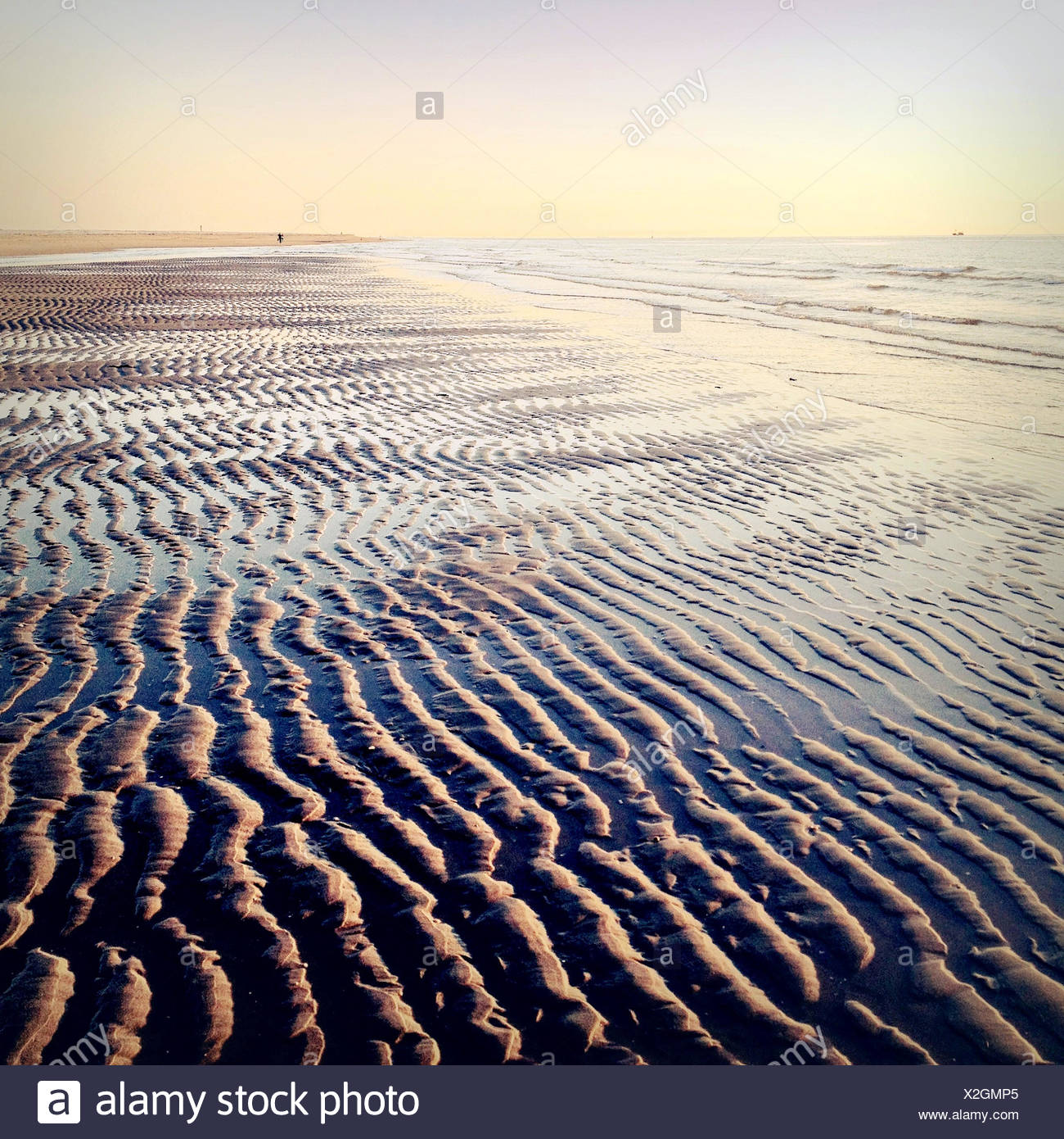 Seascape and sand on beach - Stock Image