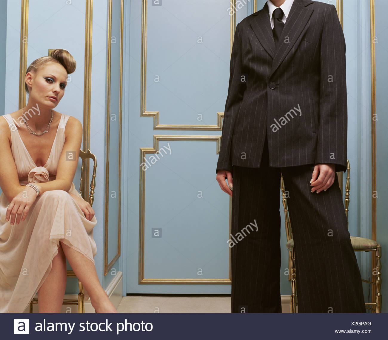 Women in masculine and feminine clothing Stock Photo
