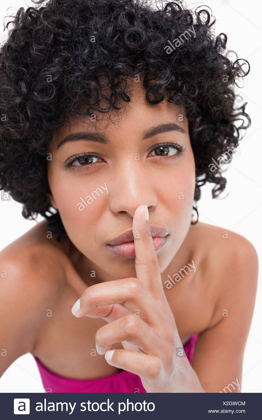 Young woman specifically asking for silence - Stock Image