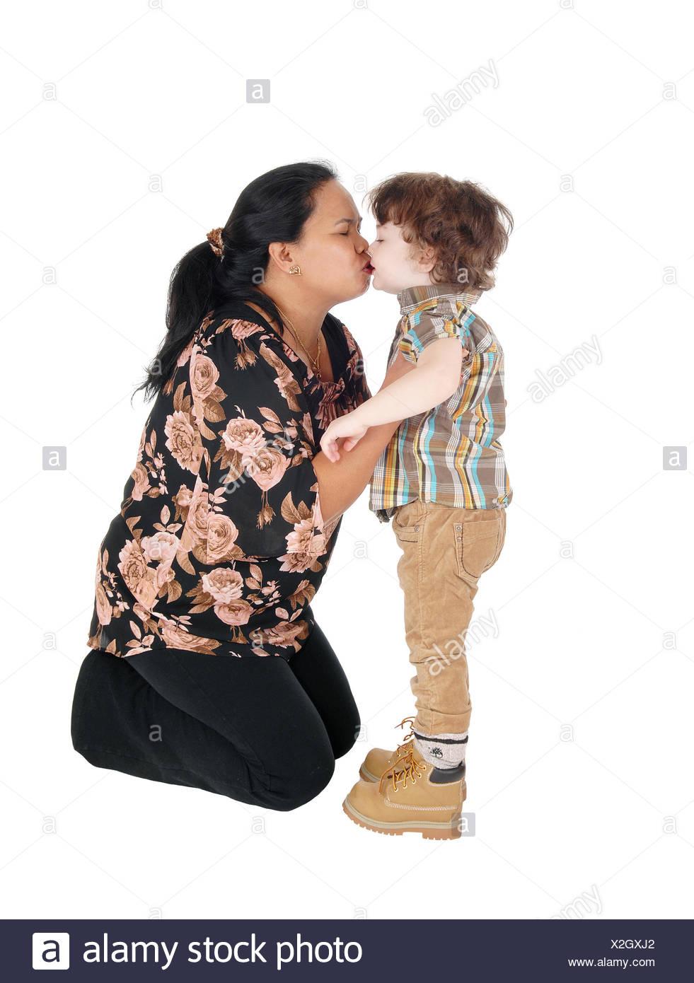Nanny kisses her little boy. Stock Photo