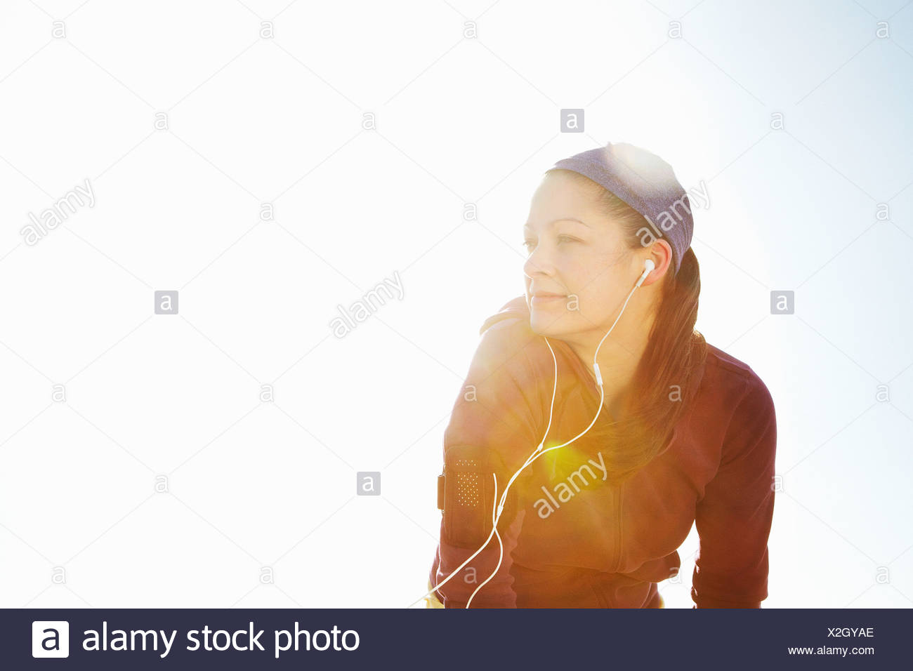 Portrait of sporty woman with lens flare - Stock Image