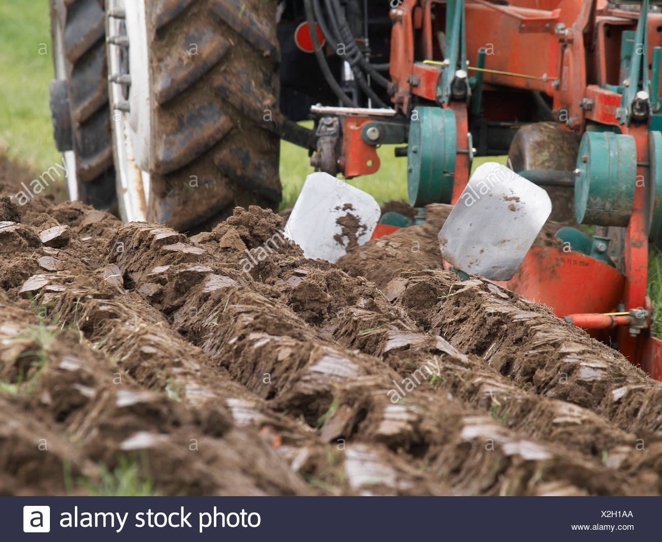 field tractor plough furrow cultivation tillage agriculture farming field farm - Stock Image
