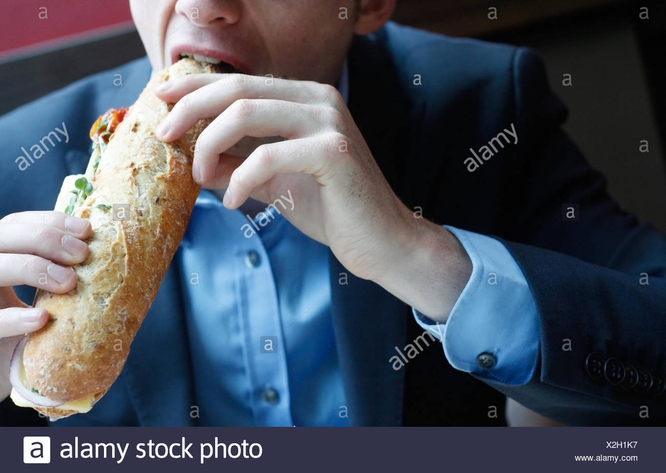 eating,sandwich,biting - Stock Image