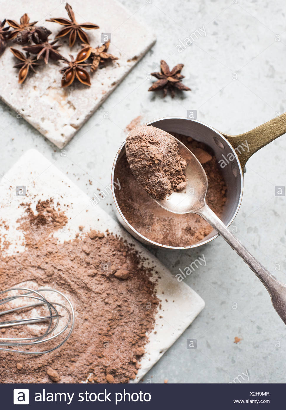 Cocoa powder mixed with sugar with star anise - Stock Image