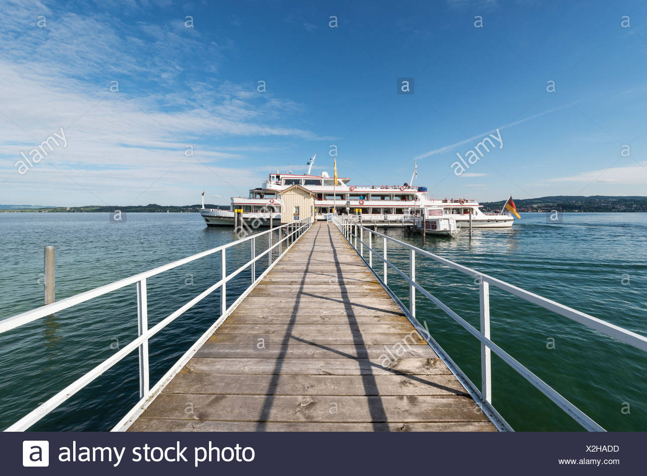 Shipping pier on Lake Constance with the MS Munich, Dingelsdorf, Baden-Wuerttemberg, Germany, Europe - Stock Image