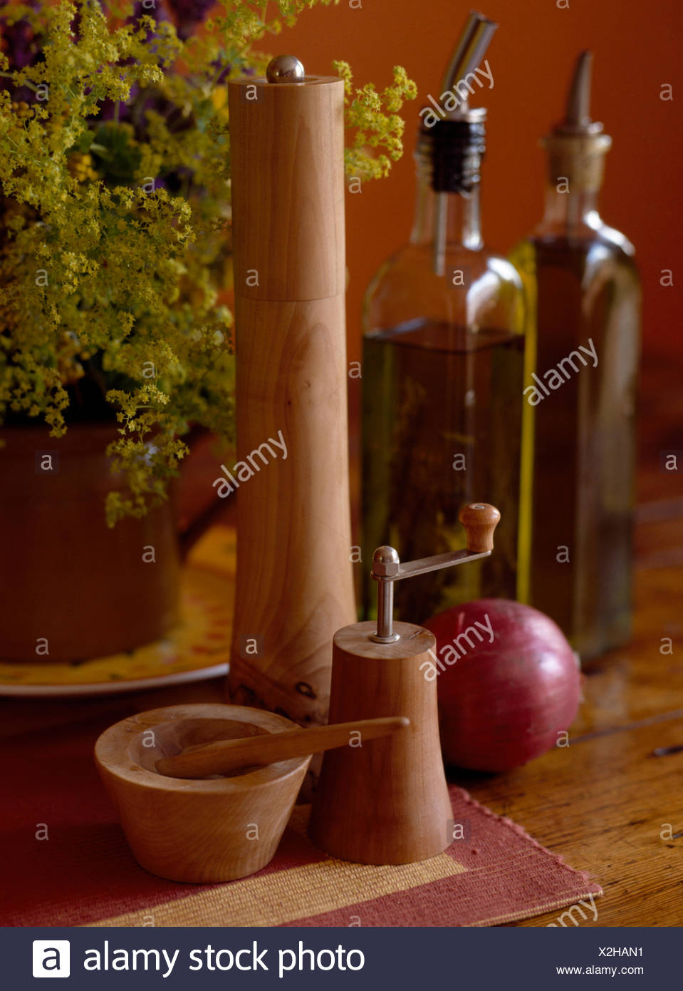 Close-up of wooden pepper mills and salt pot - Stock Image