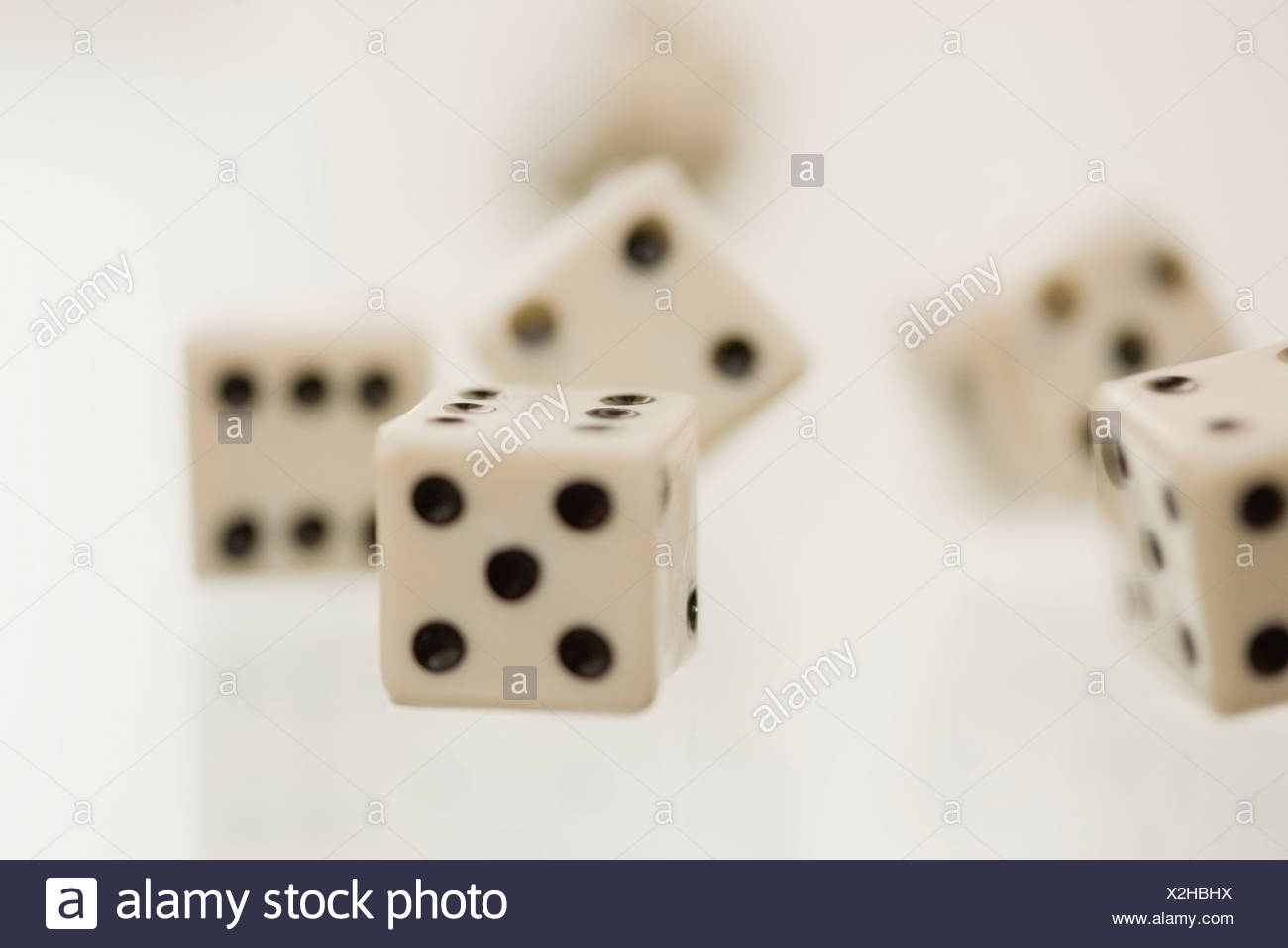 Close up of tumbling dice - Stock Image