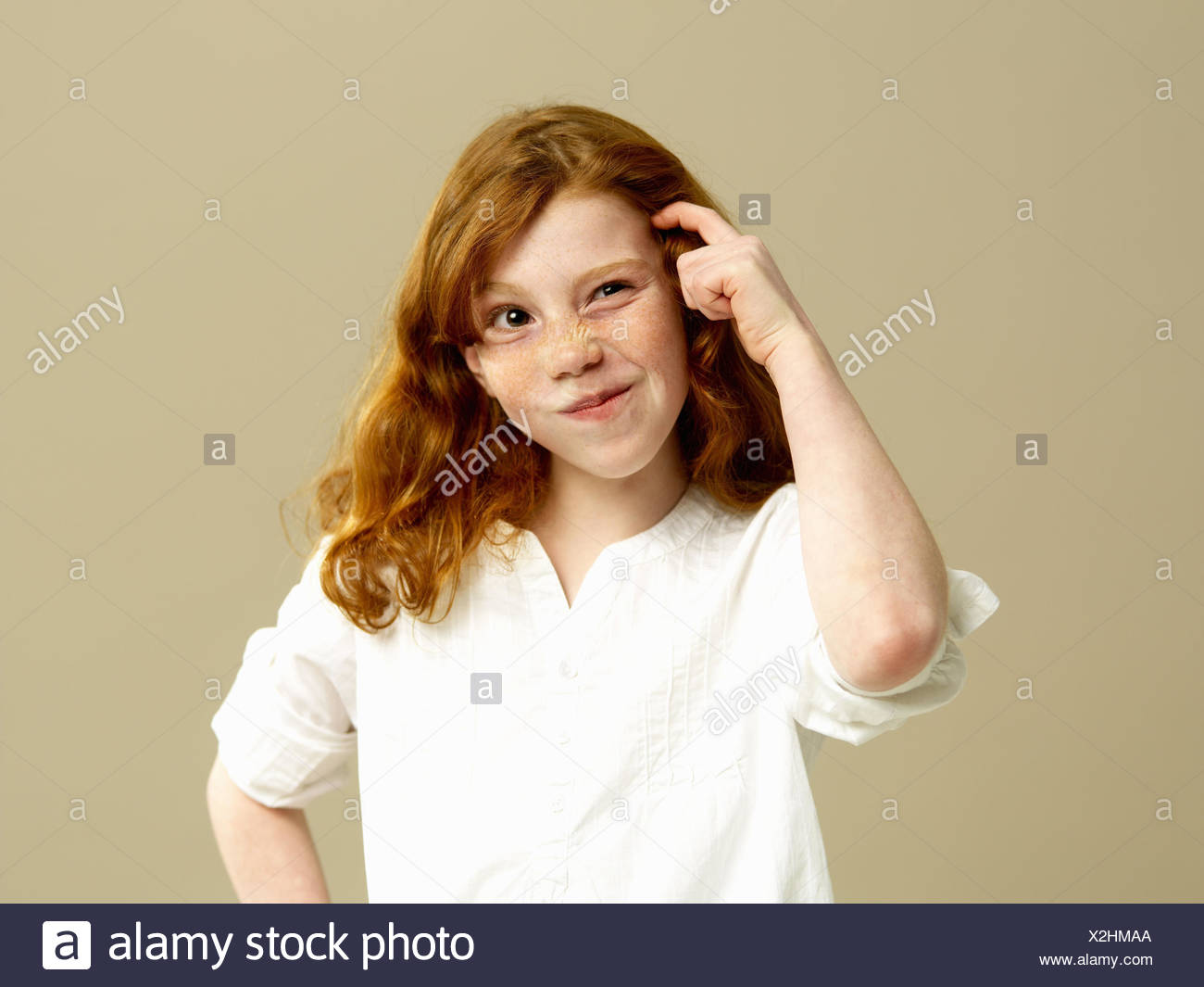 Girls, red-haired, gesture, thoughtfully, portrait, child, long-haired, blouse, shirt, freckles, brood, doubt undecided, think, consider, point tricky, Vogel, indicate, facial play, grimace, young persons, duth, childhood, side glance, studio, - Stock Image