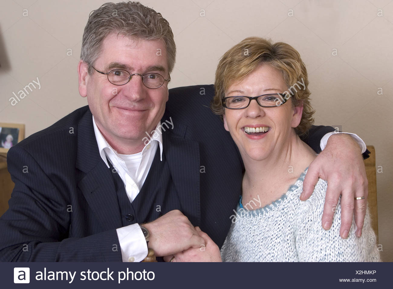Happy couple in 50's looking at camera - Stock Image