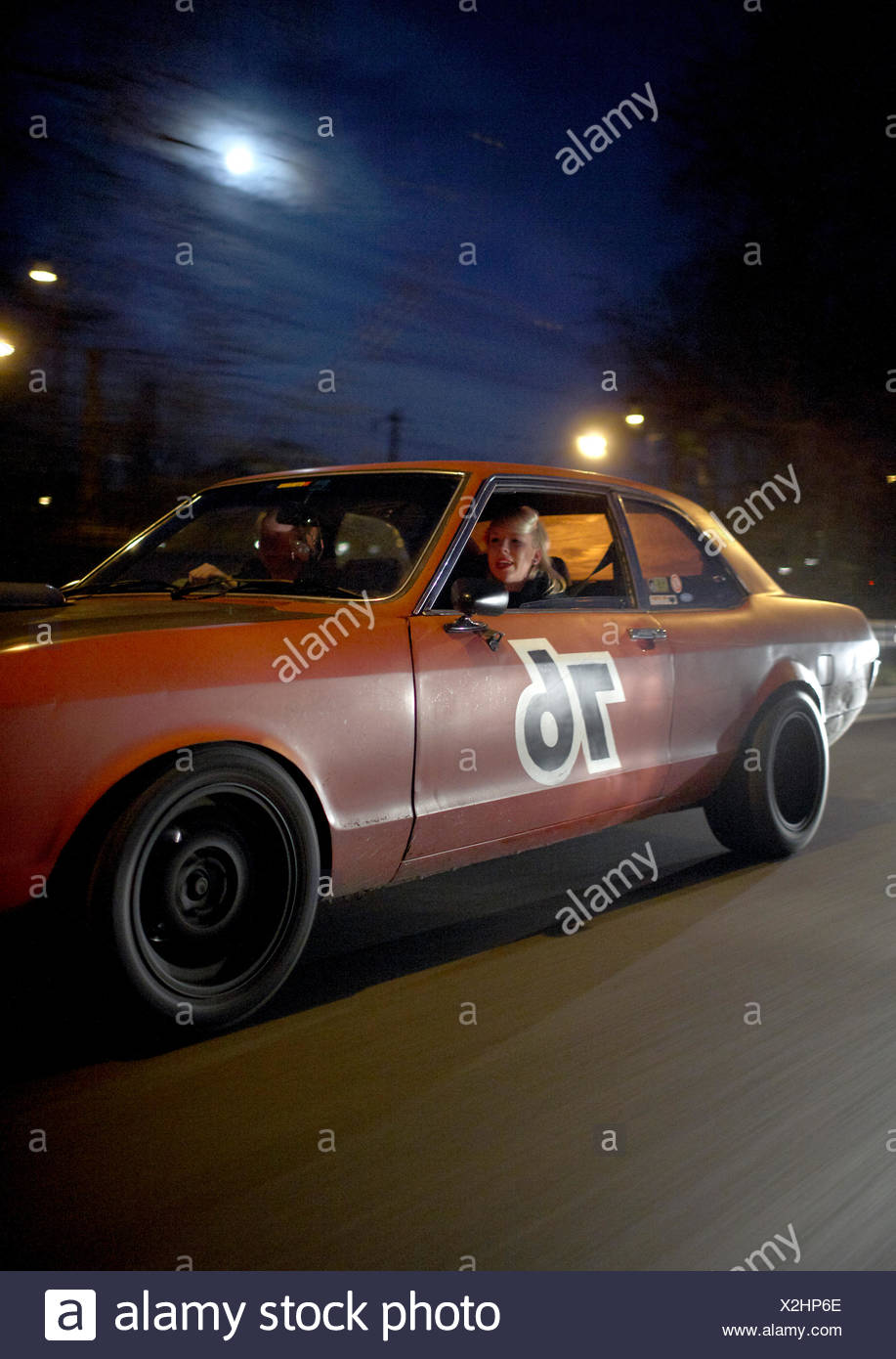 Couple in modern classic car at night, Motoraver group, Hamburg ...