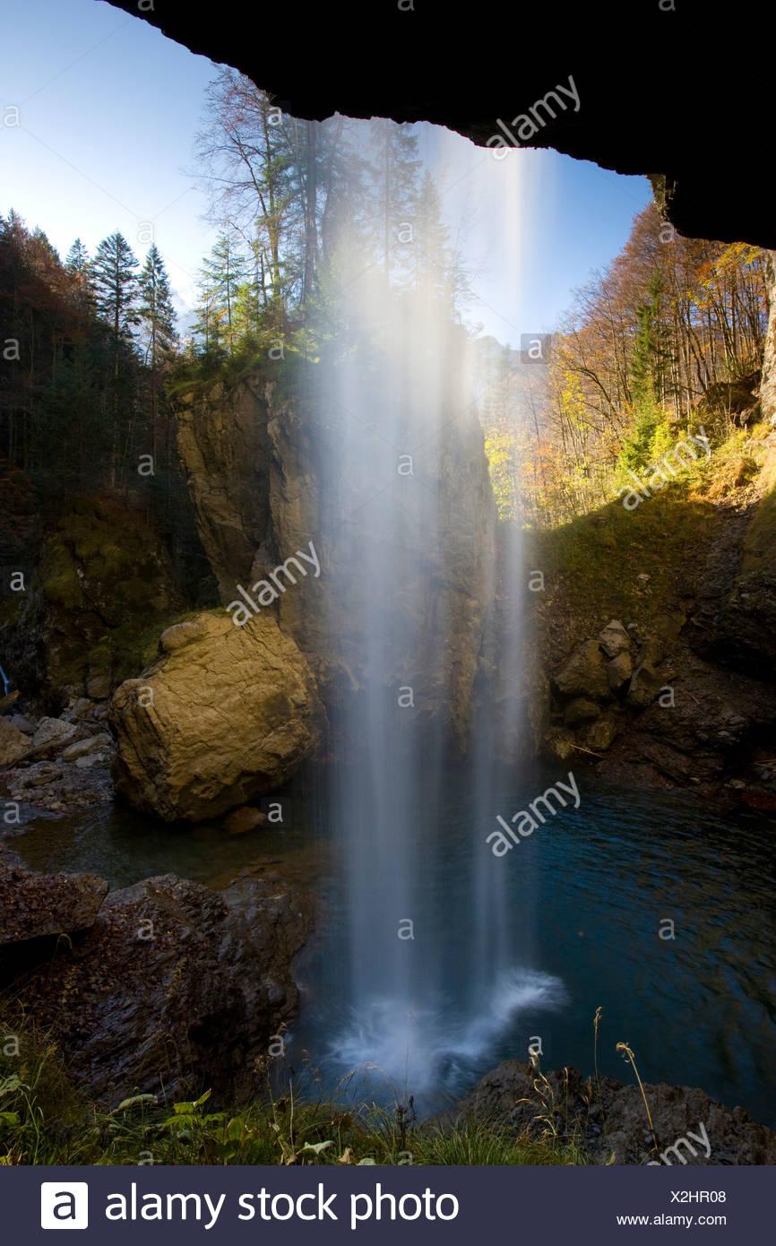 Berglistüber Switzerland Canton of Glarus waterfall brook creek wood forest autumn fall water curtain rock cliff alpine alps - Stock Image
