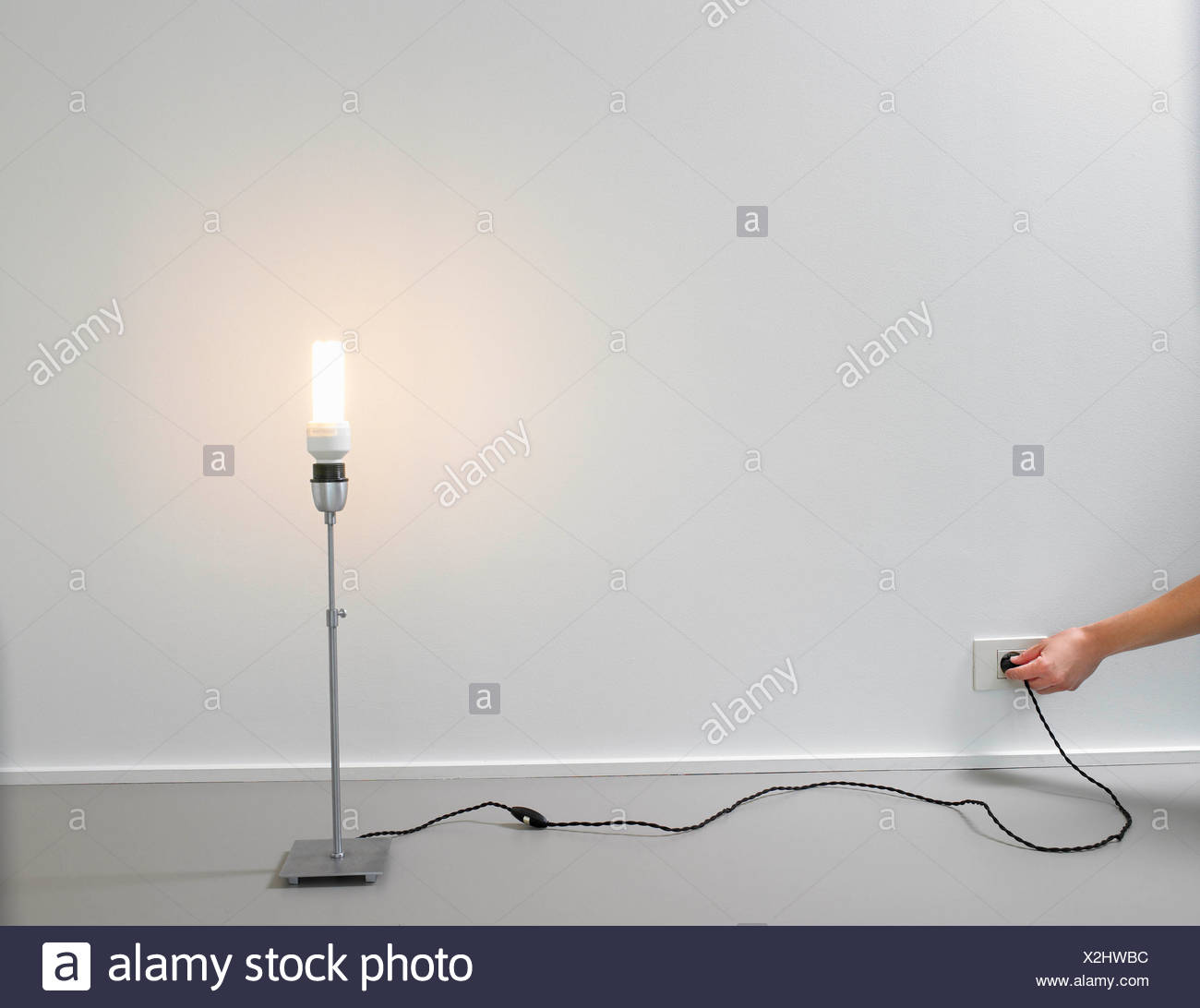 conserving energy stock photos \u0026 conserving energy stock images alamylamp with energy saver light bulb stock image