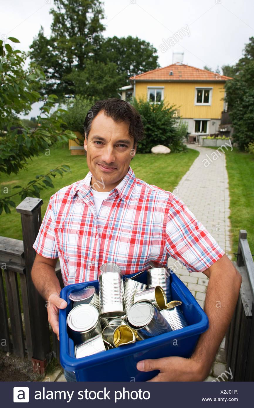 A man recycling aluminium cans - Stock Image
