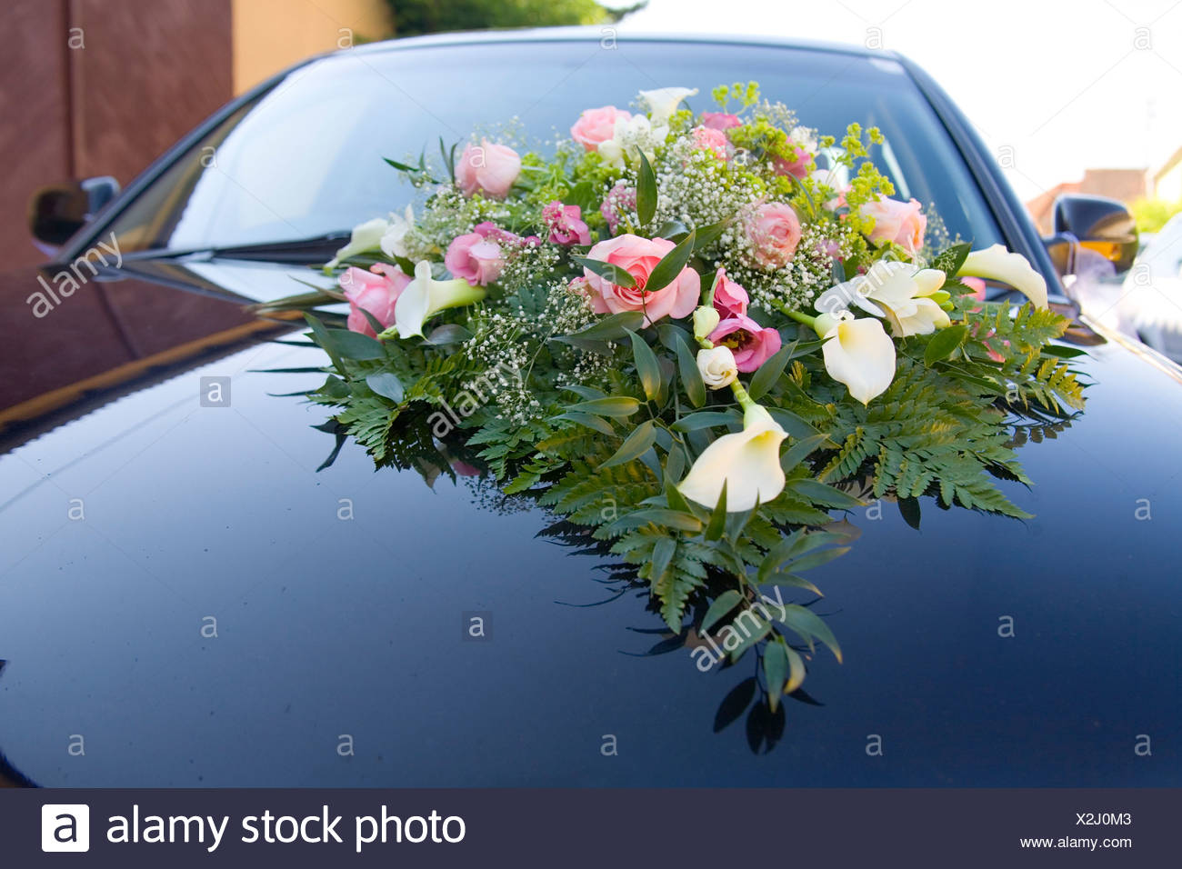Flower bouquet on a car - Stock Image