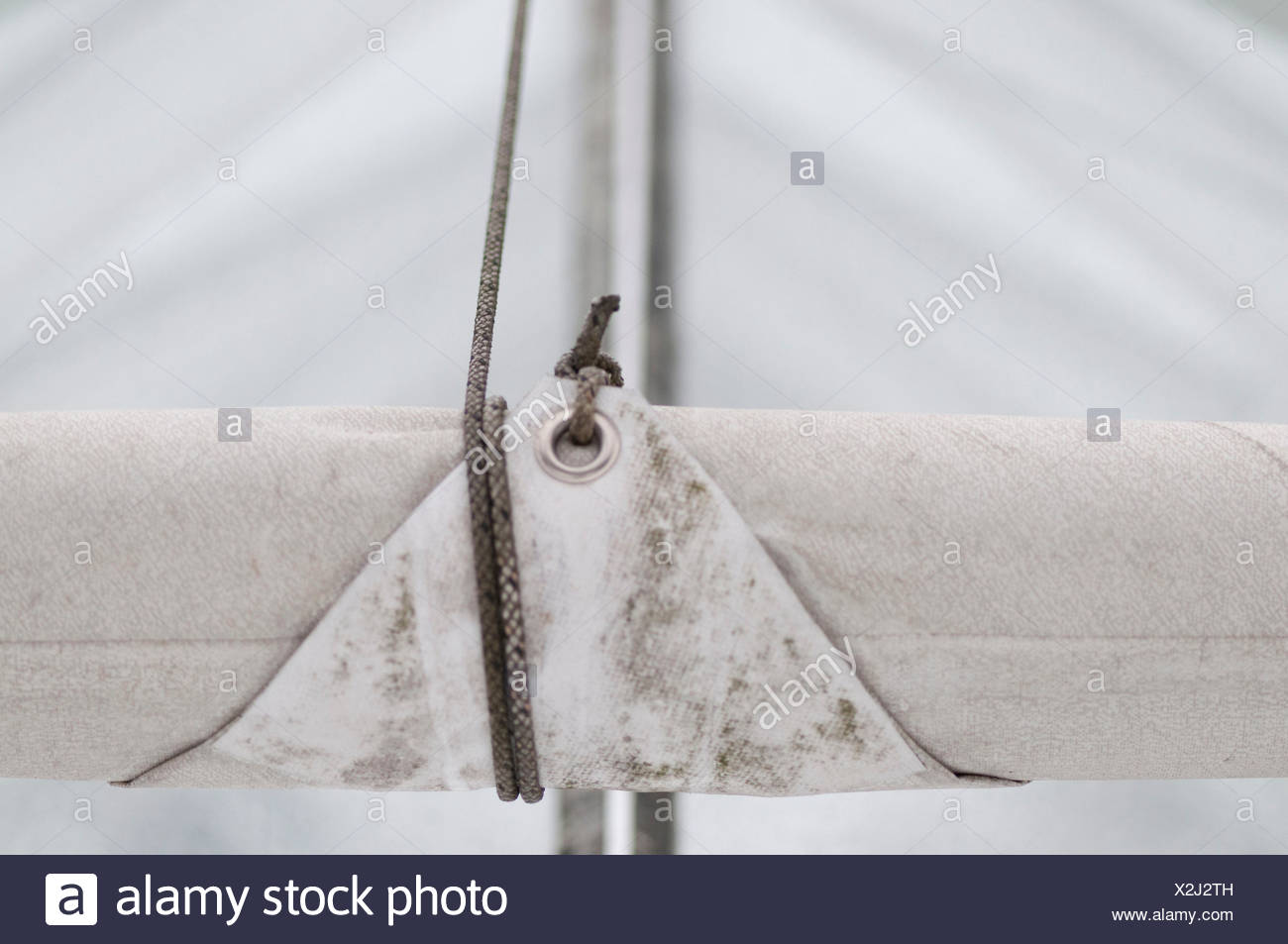 unrolled solar leech from sail cloth, detail - Stock Image