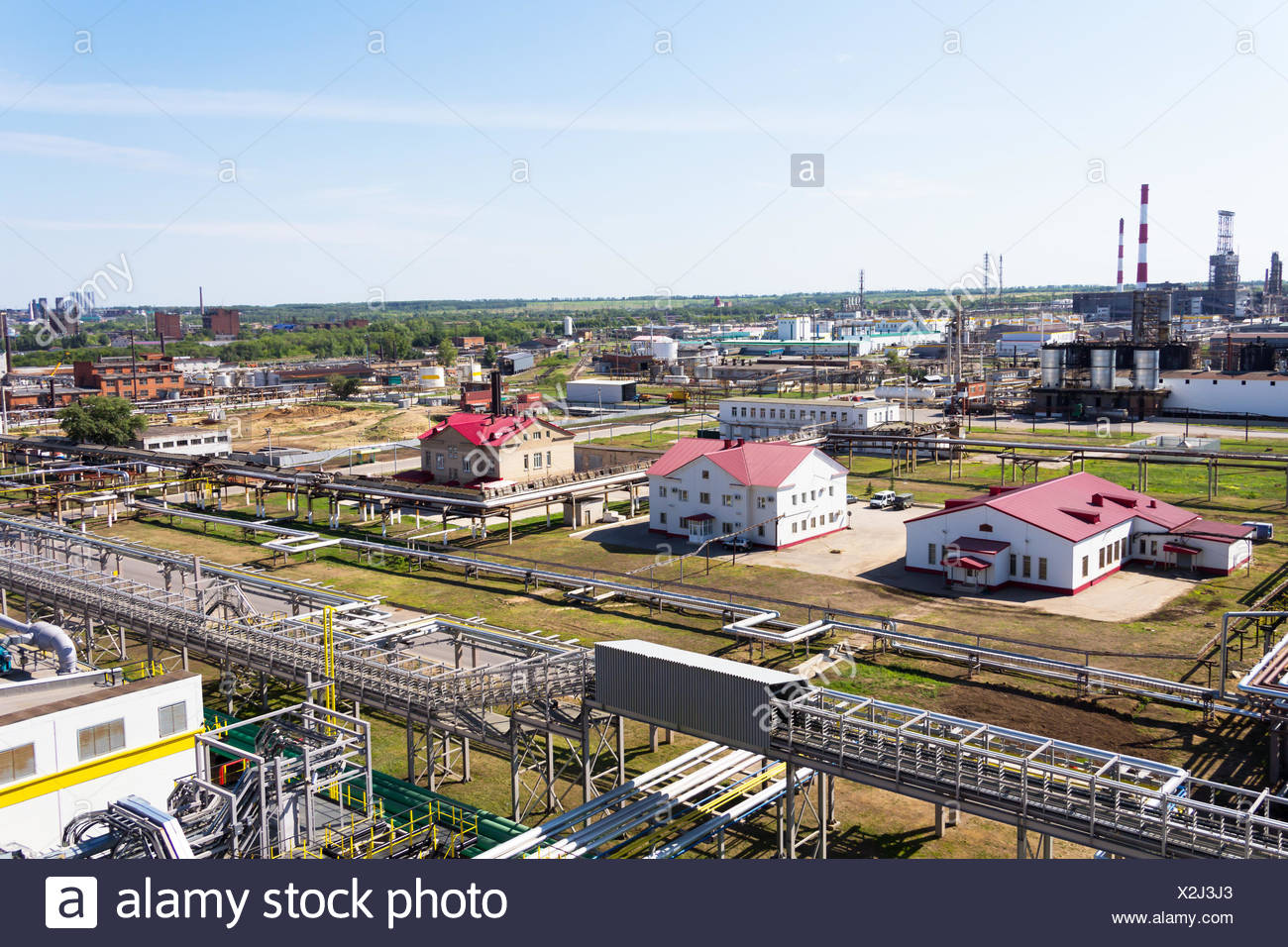 Interlacing of pipes of the oil pipeline in the summer - Stock Image
