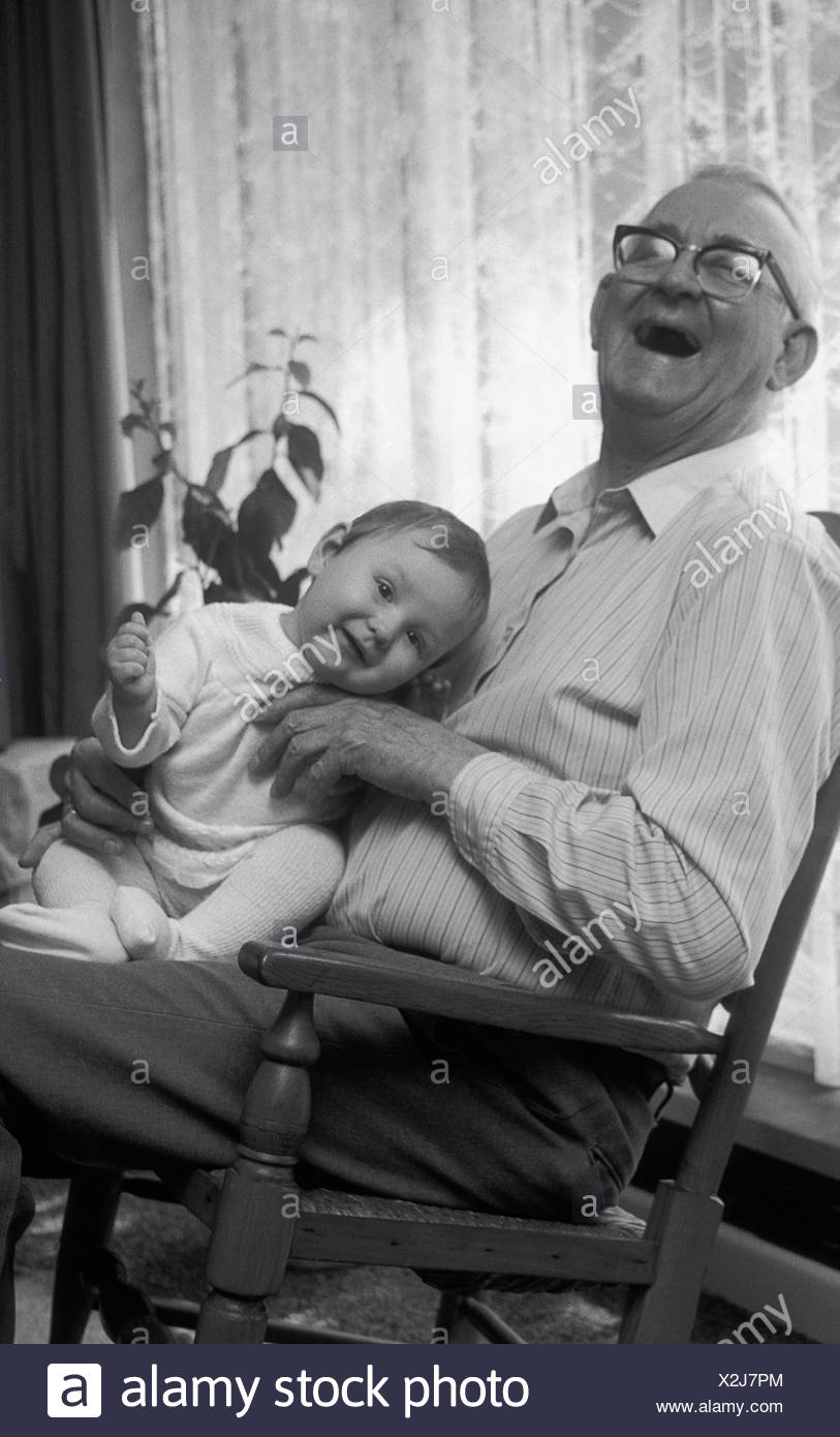 Sensational Black White Shot Happy Grandpa Holding Baby In Rocking Squirreltailoven Fun Painted Chair Ideas Images Squirreltailovenorg